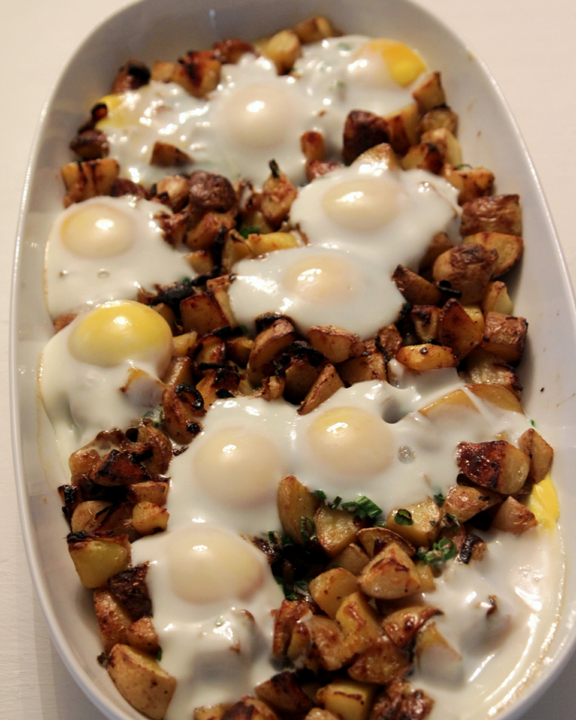 Skillet Potatoes And Onions With Fried Eggs