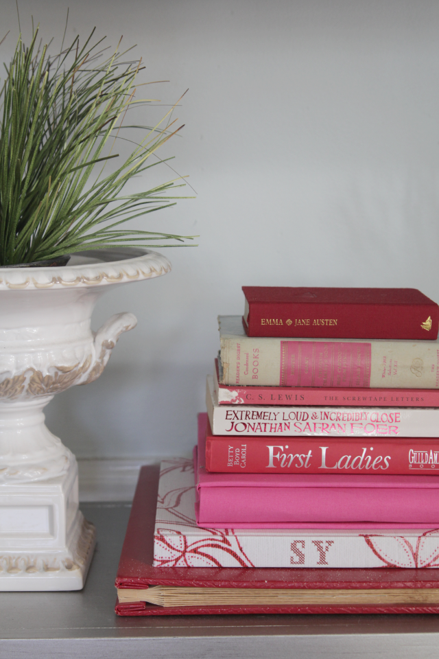 Pink & red console table books